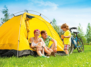 A photo of a family with a tent