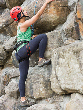 A woman climber on a rockface