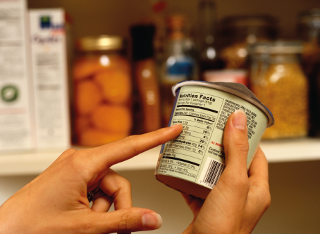 Checking ingredients on a carton