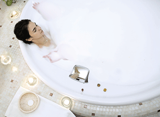 A photo of a woman in a bath
