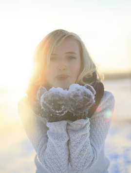 A young woman with snow on her hands