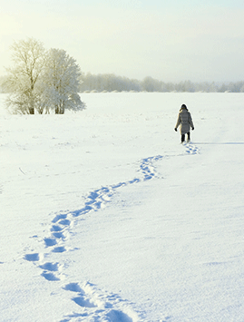 A woman walking in the snow